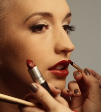 Wayne Abbott photographing model Melissa Finch, with make-up by Amy Naughalty